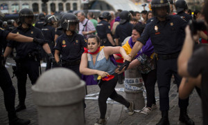 A Republican demonstrator runs away from riot police officers during