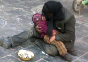1100044-child-beggar-550x389
